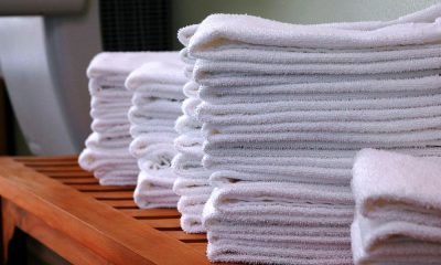 Stacks of gym towels on wood bench