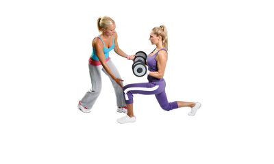 Personal trainer instructing client